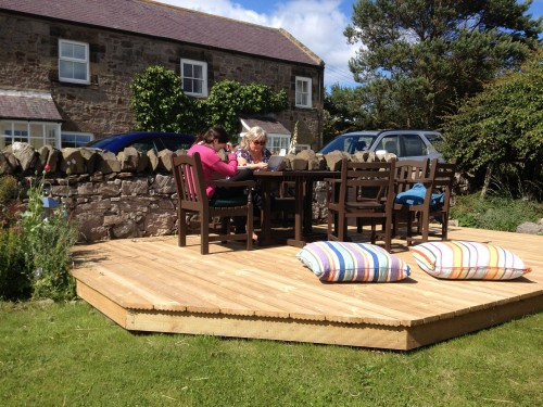 Relaxing in Front Garden on our decking 2015