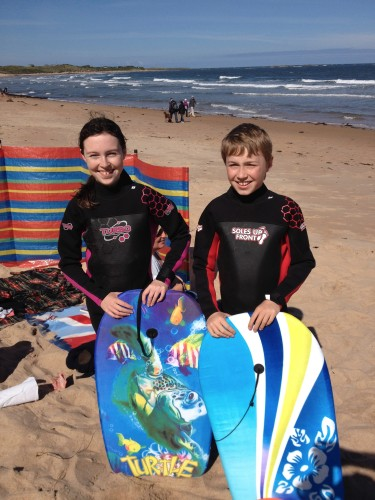 Our two at Embleton Bay about to bodyboard 2015